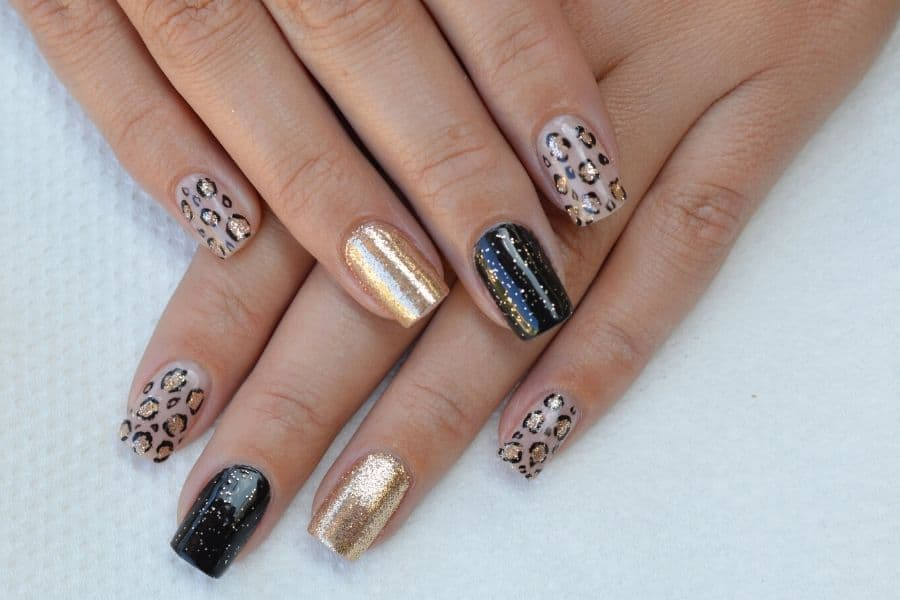 nail designs seen on the catwalk white nails with gold
